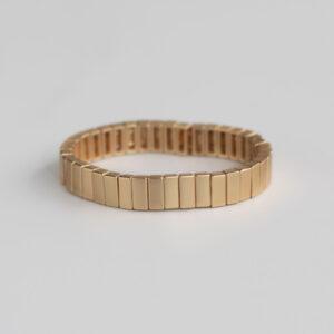 Gladis armbånd i elastik i guld fra LÈ MOSCH