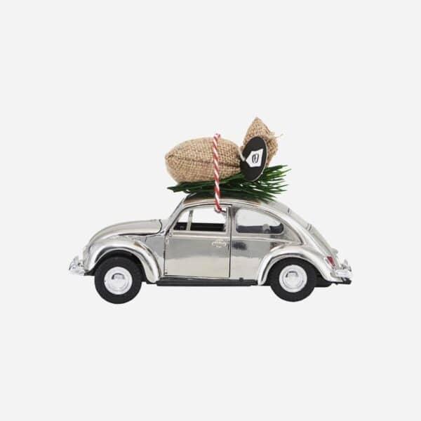Julepynt bil i sølv med julepose i sølv shopbillede