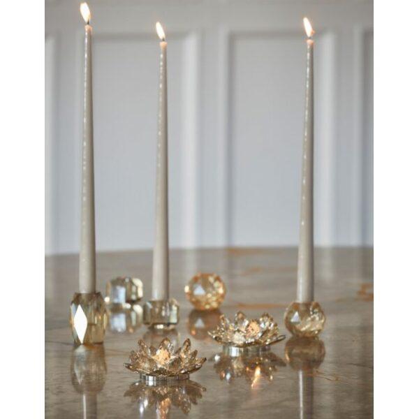 Miljøbilleder af forskellige lysestager i glas
